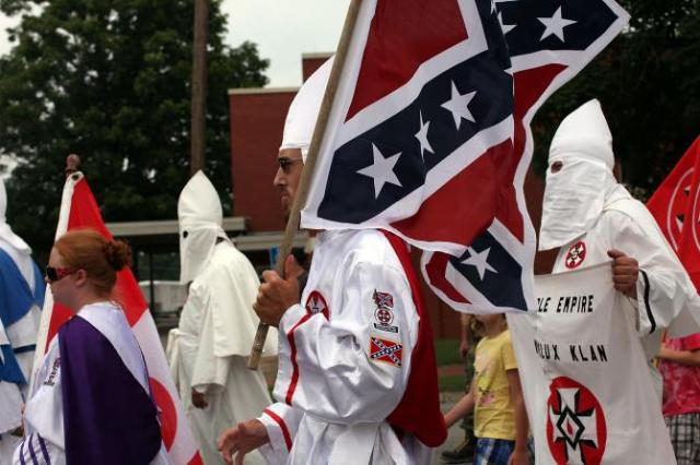 NO HATE HERE... (Members of the Fraternal White Knights of the Ku Klux Klan at Nathan Bedford Forrest Birthday march July 11, 2009, Pulaski, Tenn.   SPENCER PLATT/GETTY IMAGES)